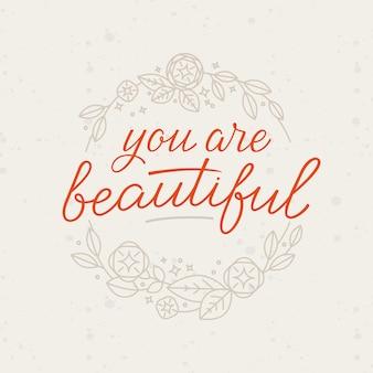 Mão-rotulação e guirlanda floral - você é linda