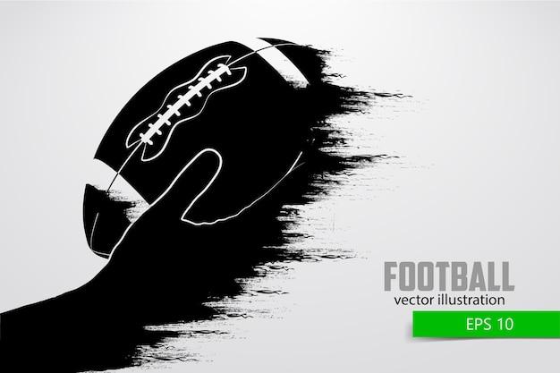 Mão segura a bola de rugby, silhueta. rugby. futebol americano. ilustração