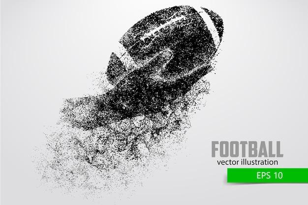 Mão segura a bola de rugby, silhueta. rugby. futebol americano