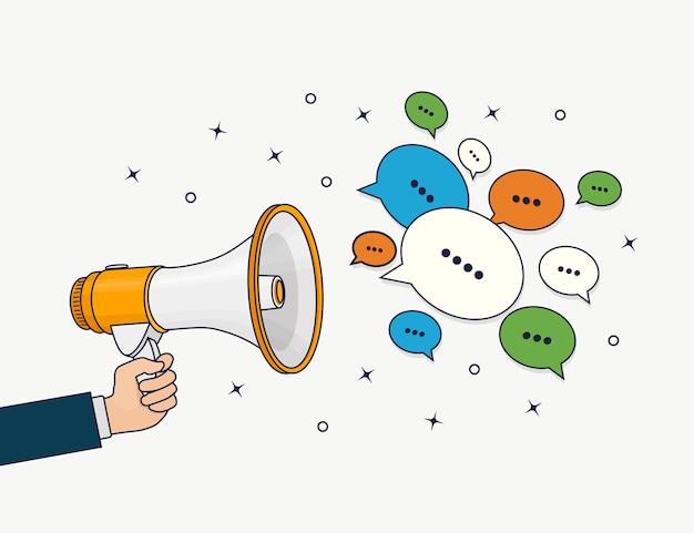 Mão segura o alto-falante. megafone com balão de fala