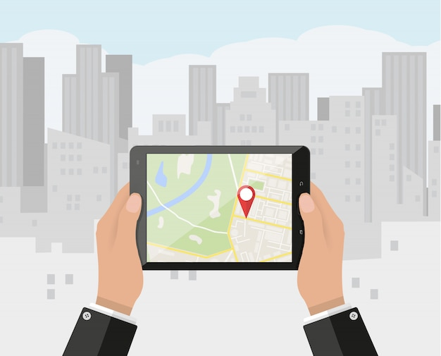 Mão segura o smartphone com o aplicativo de navegação