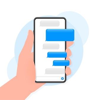 Mão segura o telefone com mensagem de bate-papo em fundo azul