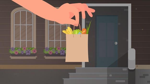 Mão segura um saco de papel com mantimentos. conceito de entrega de compras em casa. vetor.