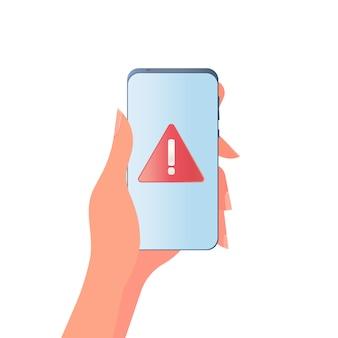 Mão segura um telefone celular. menina segura o telefone em close-up da mão. notificação de alarme e perigo. isolado.