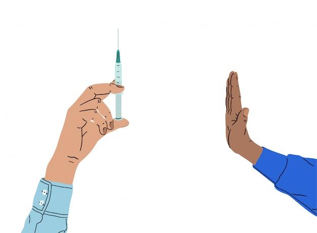 Mão segura uma seringa. pare a injeção.