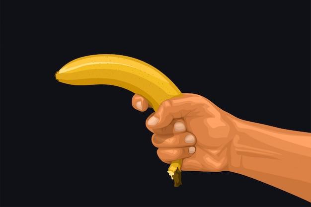 Mão segurando a banana como uma arma