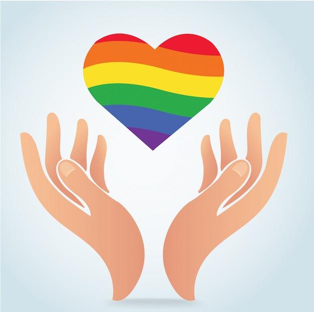 Mão segurando a bandeira de arco-íris no ícone de forma de coração