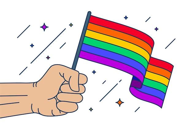 Mão segurando a bandeira do dia do orgulho