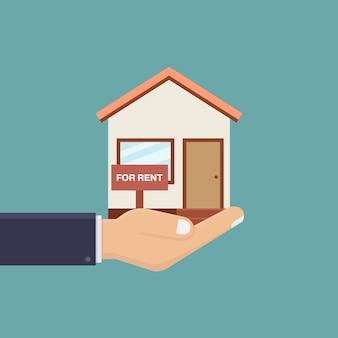 Mão segurando a casa para alugar ilustração em vetor design plano