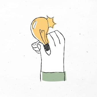 Mão segurando a energia da lâmpada