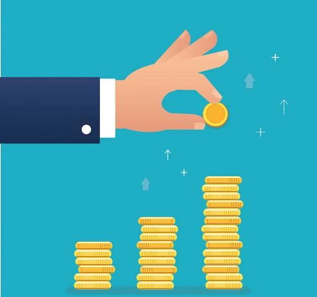 Mão segurando a moeda e construir gráfico de moeda