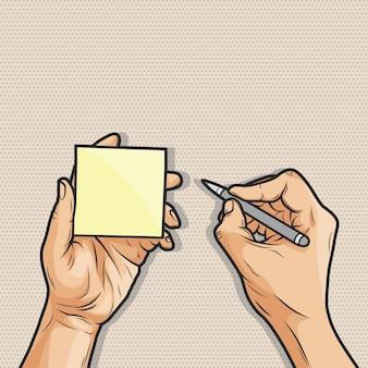 Mão segurando a nota auto-adesiva e caneta