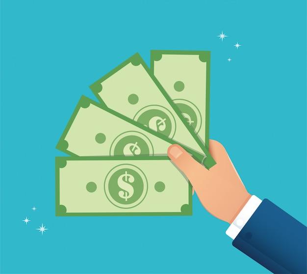 Mão segurando a nota de dólar