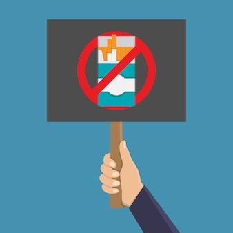 Mão segurando a placa para parar de fumar