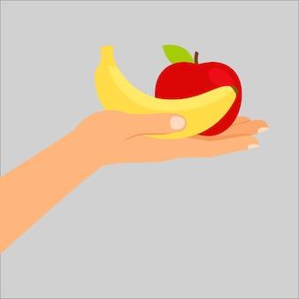 Mão, segurando, banana, e, maçã