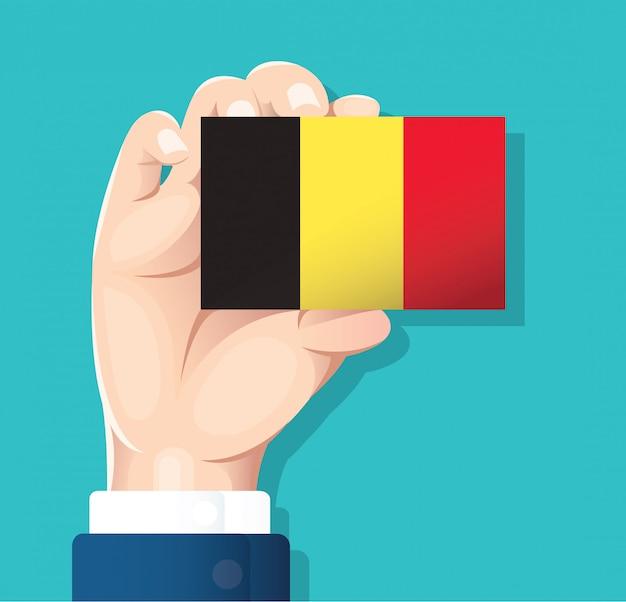 Mão, segurando, bandeira bélgica, cartão