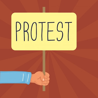Mão segurando bandeira de protesto