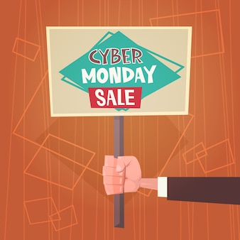 Mão segurando banner com texto cyber segunda-feira venda ofertas design on-line