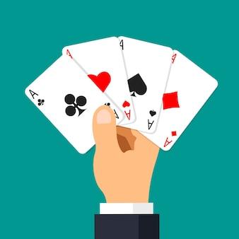 Mão segurando cartas de pôquer quatro ases isoladas em verde