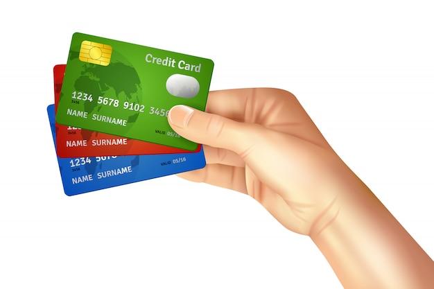 Mão segurando cartões de crédito