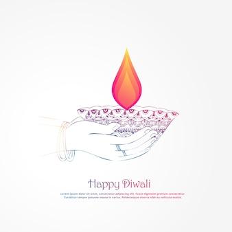 Mão segurando diya ardente, fundo do festival diwali