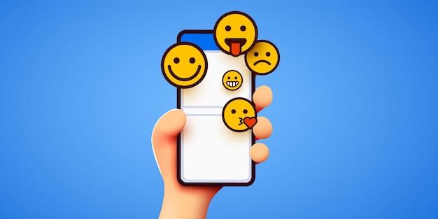 Mão segurando emoticons de telefone, mídias sociais e bate-papo do messenger