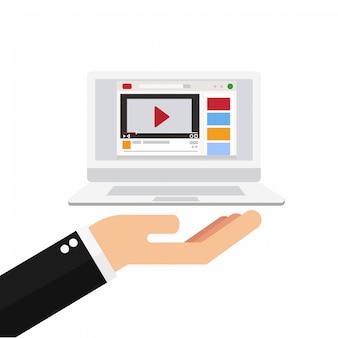 Mão segurando laptop com leitor de vídeo