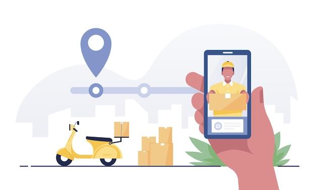 Mão segurando o aplicativo móvel que rastreia um entregador.