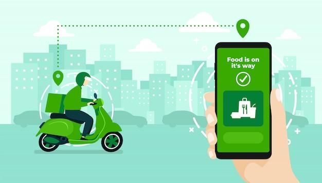 Mão segurando o aplicativo móvel, rastreando um entregador em um ciclomotor