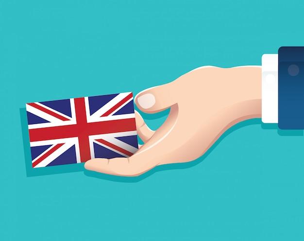 Mão segurando o cartão de bandeira de inglaterra