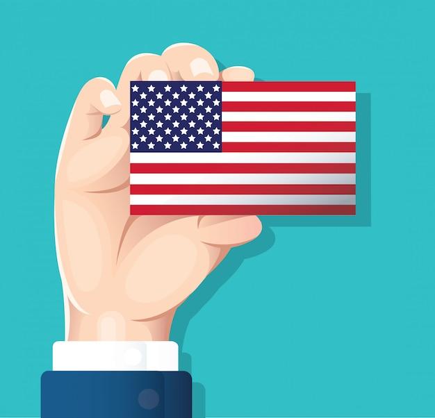 Mão segurando o cartão de bandeira eua