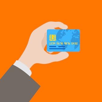 Mão segurando o cartão de crédito