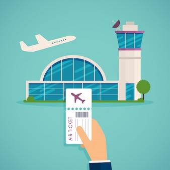 Mão segurando o cartão de embarque no aeroporto.