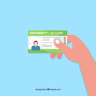 Mão segurando o cartão de identificação