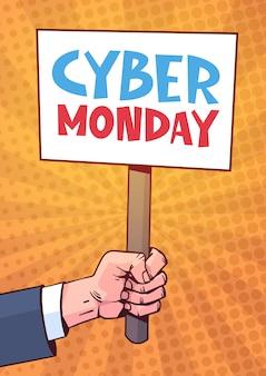 Mão segurando o cartaz com texto cyber segunda-feira