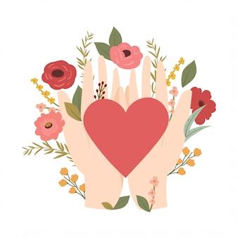 Mão segurando o coração com flores desabrochando. conceito romântico.