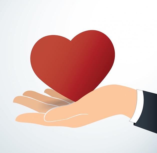 Mão segurando o coração vermelho