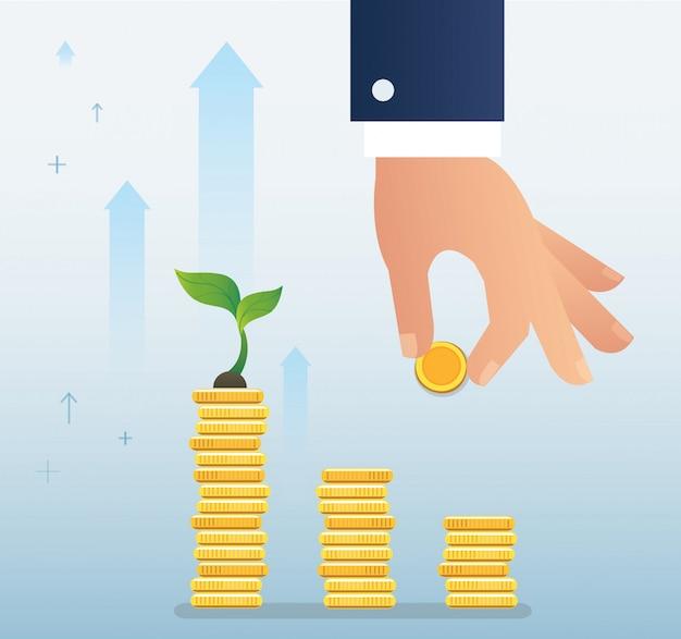 Mão segurando o crescimento de moeda e planta no gráfico de moedas