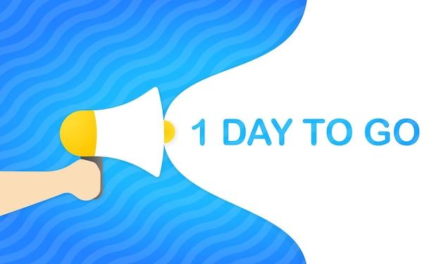 Mão segurando o megafone com 1 dia para ir mensagem no banner de discurso de bolha. alto-falante