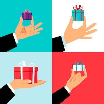 Mão segurando o pequeno conjunto de caixa de presente
