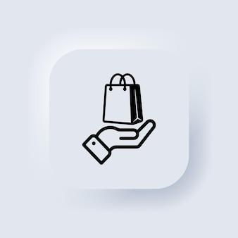 Mão segurando o saco de papel. ícone da sacola de compras. clique e receba o pedido online. vetor. compre o conceito de negócio. botão da web da interface de usuário branco neumorphic ui ux. neumorfismo. vetor
