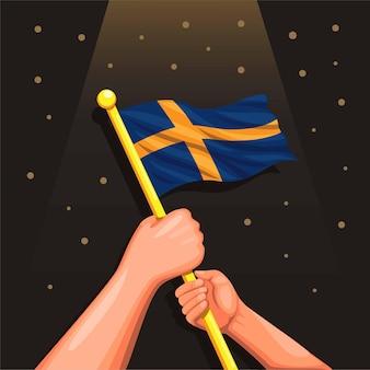 Mão segurando o símbolo da bandeira da suécia para o dia da independência da suécia em 6 de junho no conceito de desenho animado