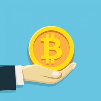 Mão segurando o símbolo de moeda do bit