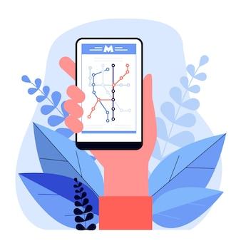 Mão segurando o smartphone com mapa do metro