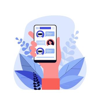 Mão segurando o smartphone com mensagens de texto