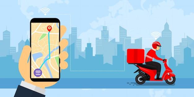 Mão segurando o smartphone com o sorriso do homem e andando de moto para entrega, para compras online