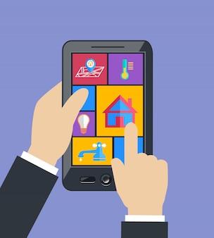 Mão segurando o tablet controla utilitários domésticos inteligentes