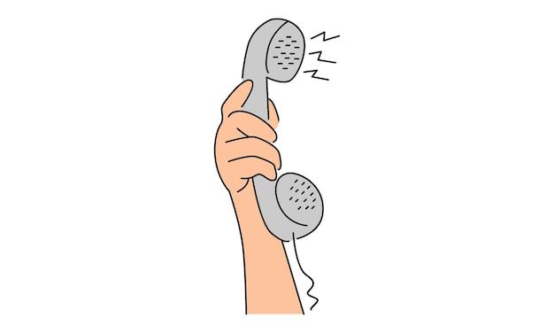 Mão segurando o telefone antigo