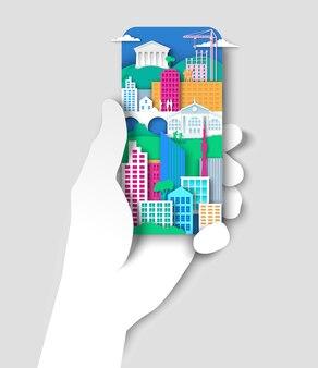 Mão segurando o telefone celular com elementos da cidade paisagem urbana