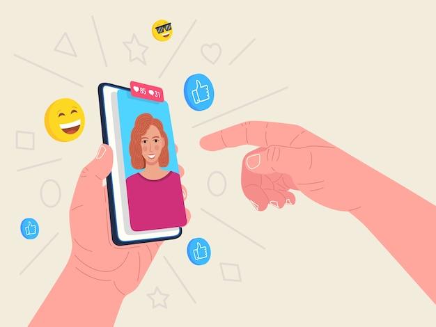 Mão segurando o telefone com avatar feminino. conceito de mídia social. .